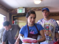 A waitress juggling plates at Big Juds Burgers in Boise forgets to smile--in some restaurants, that could endanger her job.   (Kenneth Freeman/Flickr/Creative Commons)