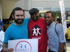 L to R: Union supporter Angel Castro stands with Hyatt workers Mike Jones and Tarrance Taylor, who were fired, then reinstated.