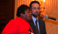Jeff Nelson (R), research director of UNITE HERE, with Charlotte Knox (L), a 25-year veteran housekeeper at the Hyatt Regency Baltimore who told the City Council that working conditions have deteriorated.   (Photo courtesy of Bill Hughes/UNITE HERE)