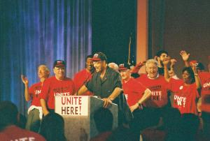 Andrew Stern, John Wilhelm, Bruce Raynor surround Jesse Jackson at 2004 founding Convention of UNITE HERE.