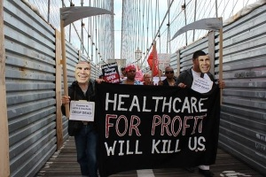 Nurses and supporters marched over the Brooklyn Bridge this summer to protest the closure of the Long Island College Hospital. (Photo from NYSNA).