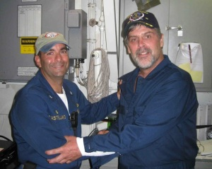 Captain Phillips (right) with Commander Frank Castellano. (Wikimedia Commons)