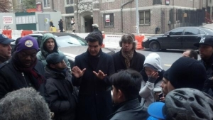 New York City Councilman Ydanis Rodriguez rallies with fired Domino's workers.