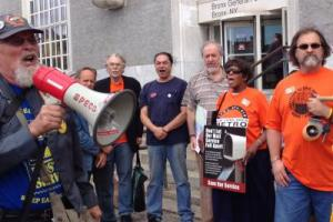 Members of three postal unions and community supporters gathered outside a Bronx post office slated for closure. The laid-off workers may be replaced by Staples workers. Photo: Alexandra Bradbury.