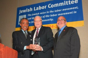 (l-r) Rev. Al Sharpton, President of the National Action Network; Lee Saunders, President of the American Federation of State, County and Municipal Employees; and JLC President Stuart Appelbaum at the JLC's awards dinner in New York, June 19th. (Miller Photography)