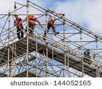 worker-on-a-scaffold-symbolfoto-for-building-construction-boom-labor-protection-144052165